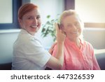 female nurse combing hair of... | Shutterstock . vector #447326539