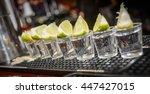 line of tequila shots | Shutterstock . vector #447427015