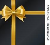 golden bow ribbon on black.... | Shutterstock . vector #447484339