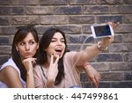 Two Girls Making Selfie Outdoors