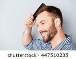 portrait of handsome cheerful... | Shutterstock . vector #447510235
