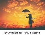 silhouette of umbrella woman...