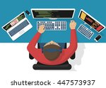 programmer at computer desk... | Shutterstock .eps vector #447573937