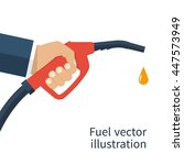 fuel pump in hand man. petrol... | Shutterstock .eps vector #447573949