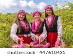 Stock photo three bulgarian girls dressed in traditional dress picking roses during the annual rose festival in 447610435
