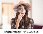 surprised woman with magnifying ... | Shutterstock . vector #447620515