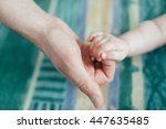 the father keeps  fingers of... | Shutterstock . vector #447635485