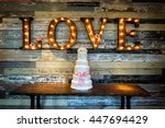 wedding cake with the word love ... | Shutterstock . vector #447694429
