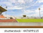 empty brown wooden table top on ... | Shutterstock . vector #447699115