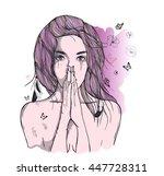 sad woman prays | Shutterstock .eps vector #447728311