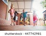 three kids running in the... | Shutterstock . vector #447742981