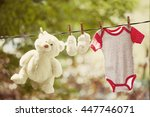 Baby Girl Clothes Hanging On...