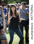 Small photo of Amsterdam, The Netherlands - July, 3 2016: young woman dancing during concert of alternative Algerian band Djmawi Africa at Amsterdam Roots Open Air, free public cultural festival held in Oosterpark
