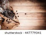 coffee bean on grunge wooden... | Shutterstock . vector #447779341