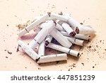 heap of the broken cigarettes   Shutterstock . vector #447851239