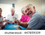 group of seniors playing cards... | Shutterstock . vector #447859339