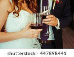bride and groom clang glasses... | Shutterstock . vector #447898441