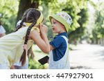 cute girl and boy listening to... | Shutterstock . vector #447927901