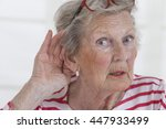 Small photo of Mature woman holding hand to hear