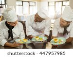 smiling chefs team holding... | Shutterstock . vector #447957985