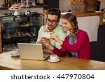 two hipsters friends looking at ... | Shutterstock . vector #447970804