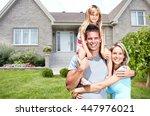 happy family near new house. | Shutterstock . vector #447976021