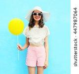 fashion pretty woman in straw... | Shutterstock . vector #447987064