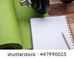 yoga mat  notebook  dumbell and ...   Shutterstock . vector #447990025