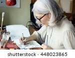 Asian Senior Woman Artist...