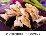 deep-fried pastries with icing sugar and donuts for carnival party - stock photo