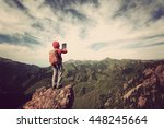 successful woman backpacker use ... | Shutterstock . vector #448245664