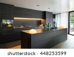 modern kitchen with black...