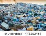 plastic waste dumping site | Shutterstock . vector #448263469