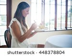 smiling woman sitting in... | Shutterstock . vector #448378804