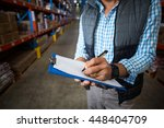 close up of worker writing... | Shutterstock . vector #448404709
