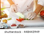 hand with knife cuts asparagus. ... | Shutterstock . vector #448443949