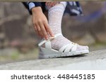 little girl putting on her... | Shutterstock . vector #448445185