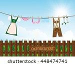 Stock vector oktoberfest background outdoors lederhosen dirndl panties lingerie socks hanging on clothes 448474741