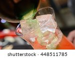 summer cocktail being poured | Shutterstock . vector #448511785