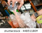 cocktails being poured at a bar  | Shutterstock . vector #448511809
