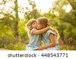 two cute little sisters hugging ...   Shutterstock . vector #448543771
