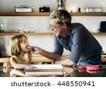 father daughter helping cooking ... | Shutterstock . vector #448550941