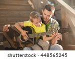 father learning his boy to play ... | Shutterstock . vector #448565245