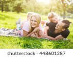 family playing in the park on... | Shutterstock . vector #448601287