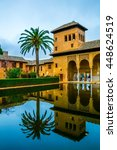 Small photo of Alhambra de Granada. El Partal. A large central pond faces the arched portico behind which stands the Tower of the Ladies