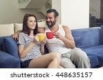 beautiful young couple drinking ... | Shutterstock . vector #448635157