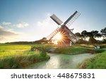 sunshine behind dutch windmill  ... | Shutterstock . vector #448675831