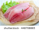 Raw Tilapia Fish Fillet With...