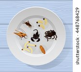 Cooked Insects In A Plate On...