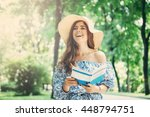 elegant female with a hat on... | Shutterstock . vector #448794751